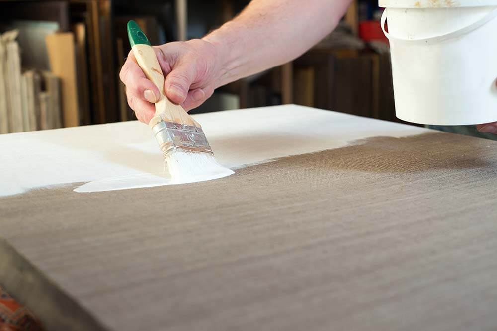 priming a canvas for watercolors