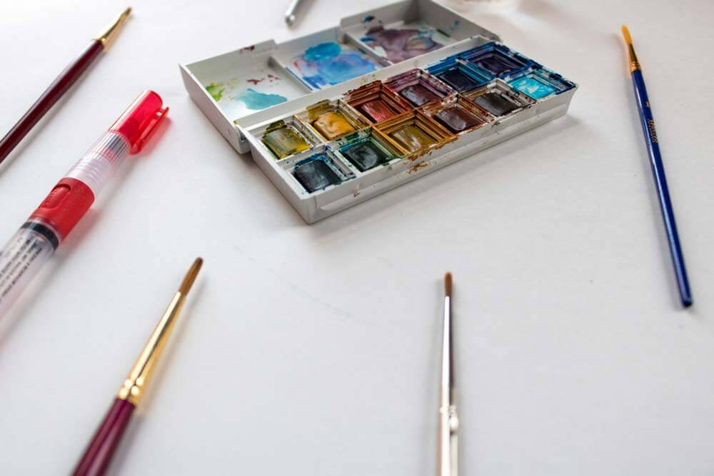 reviewing a variety of watercolor brushes